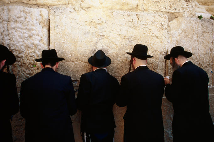 Men pray by the Western Wall (Wailing Wall).