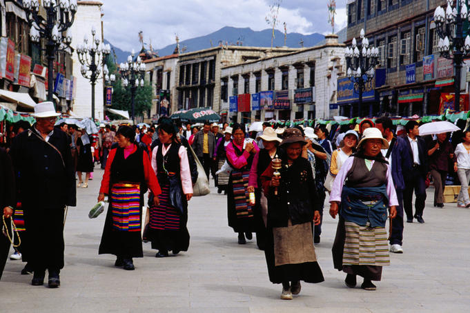 Pilgrims walking the Barkhor Kora Pilgrimage Circuit, Tibetan old quarter.
