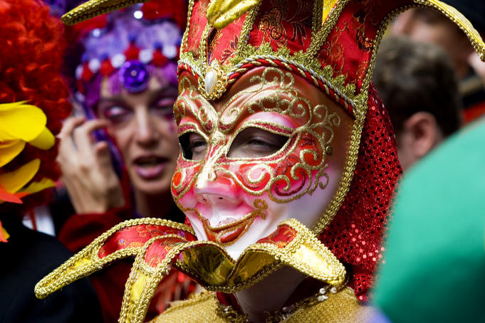 Person in Venetian mask, New Orleans Mardi Gras.