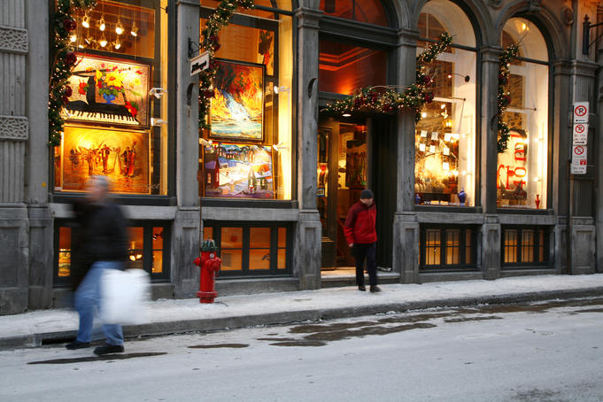Illuminated art shop window in winter, Rue St. Paul, Old Montreal.