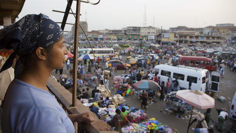 Traveller looking over Kejetia Market.