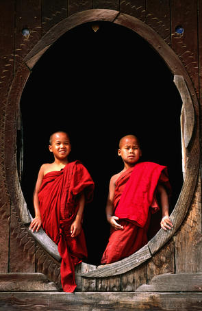 Young monks in window, Shwe Yaunghwe Kyaung temple.