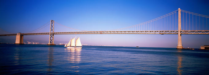 Sail boat under the Bay bridge.