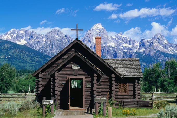 The Chapel of the Transfiguration, built in the traditional log-cabin style, and the Teton Range - Grand Teton National Park, Wyoming