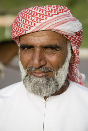 Portrait of Muslim man in dishdash and gutra in Jebel Hafeet Park.