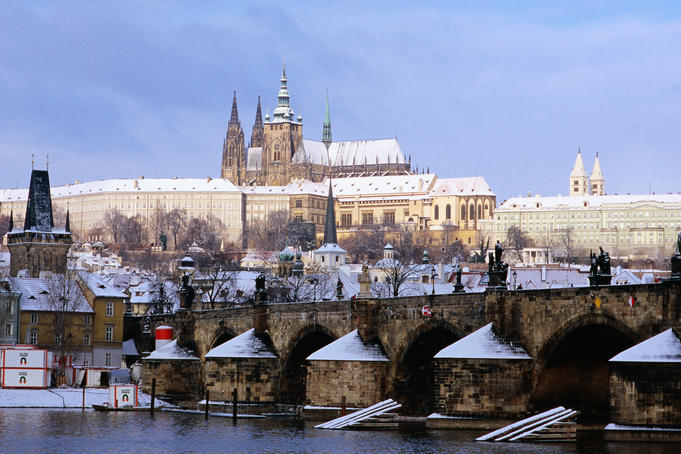 Snow covered Prague Castle, Charles Bridge and suburb of Mala Strana.