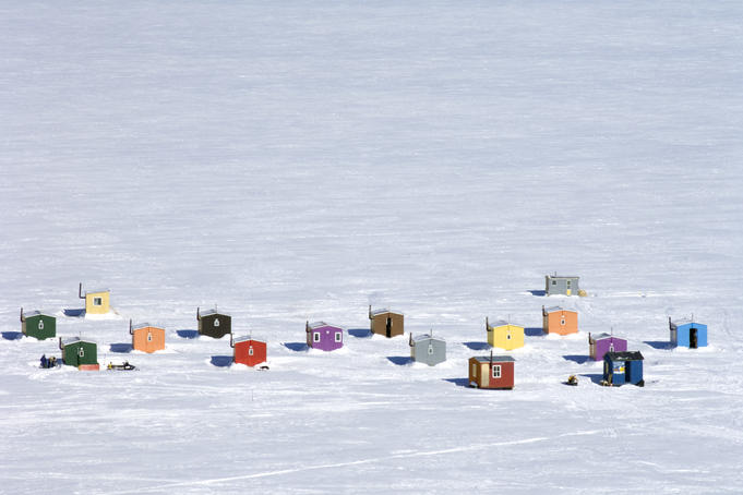 Overhead of ice fishing huts.