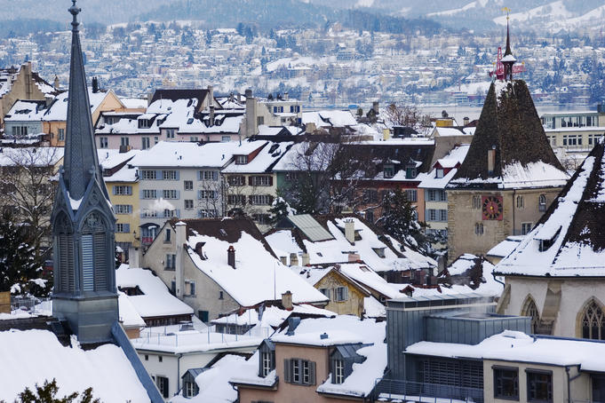 Overhead of snow-covered roofs with the Grimmenturm (medival residential tower), Neumarkt.