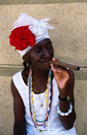 Cuban woman smoking cigar, Plaza de Armas.