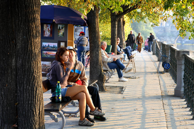 Autumn colours and people along Vltava Moldau River.