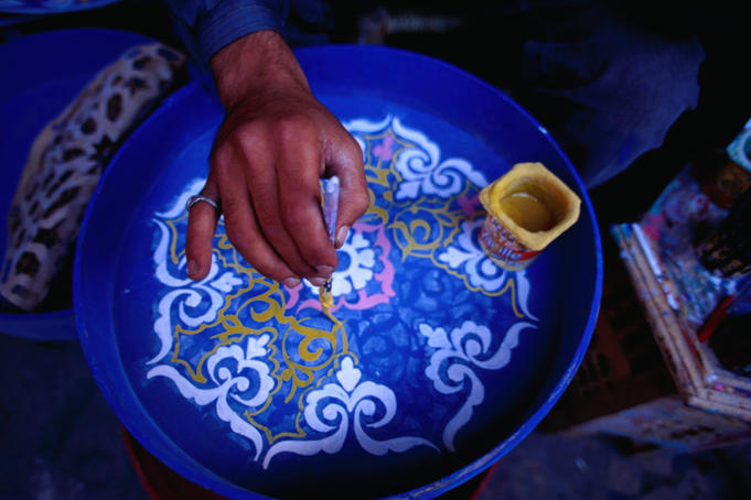 Hand painting ceramics in the Potters Souq of the medina, Marrakesh