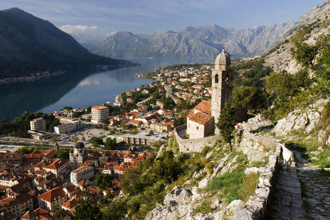 Old church on rocky mountain above town of Kotor.