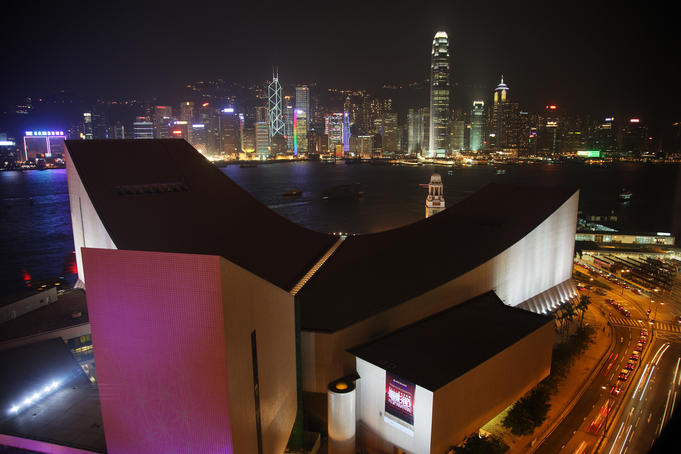 Hong Kong Cultural Centre,Tsim Sha Tsui, with Central District skyline across Victoria Harbour in background.