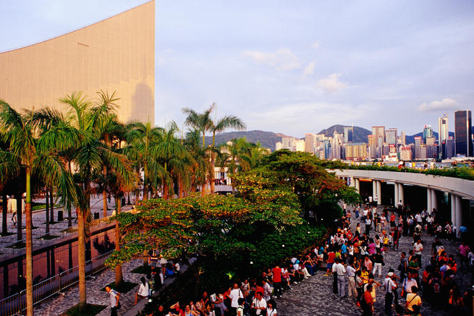 Tourists on Tsim Sha Tsui Promenade near Cultural Centre.