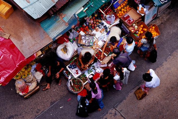 People at fruit stall on Cage Street.