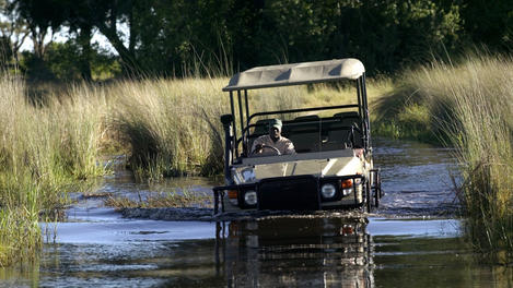 vehicle crossing waters of Delta, Botswana
