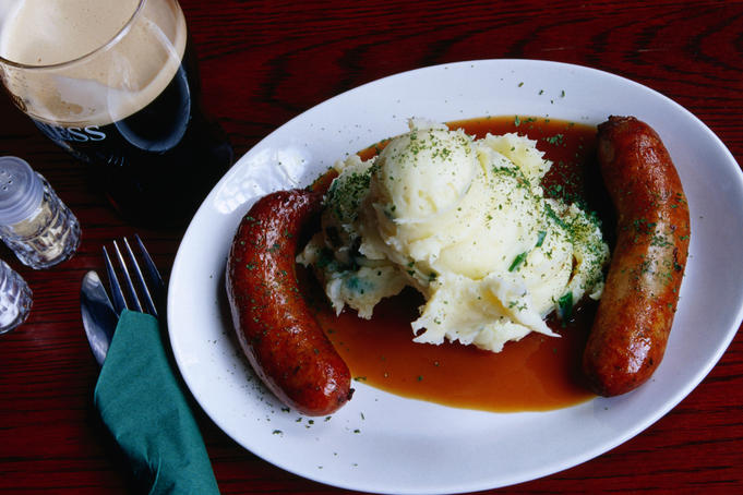Bangers ( sausages ), mash ( poatato ) and a beer
