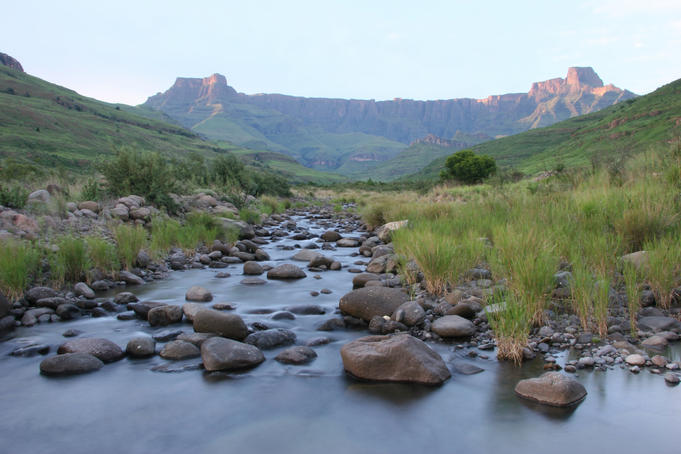 Sunrise over stream with Table Mountain in background.