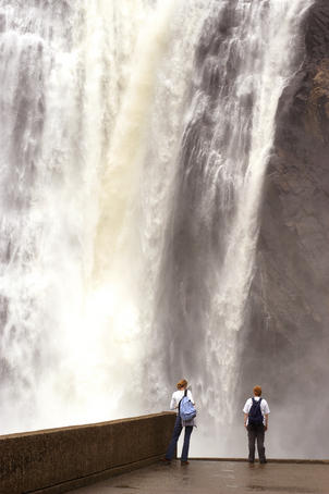 People standing below Montmorency Falls.