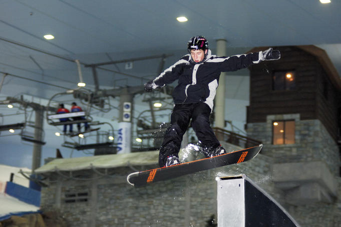 Snowboarder during Ski Dubai freestyle night.