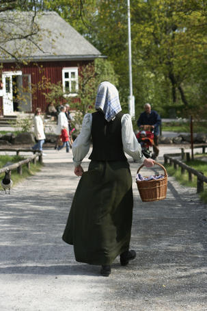 Woman in period costume at Skansen.