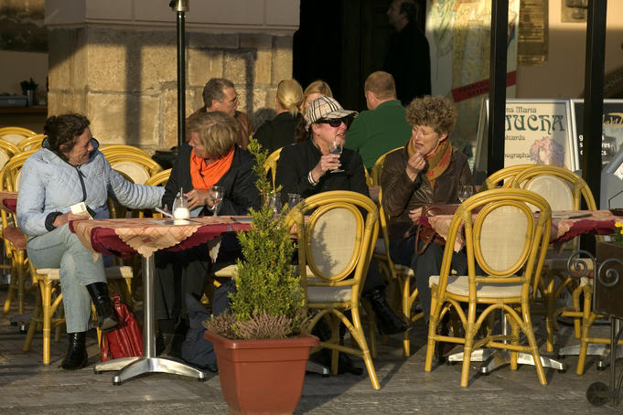 People drinking outside a cafe, Old Town Square.