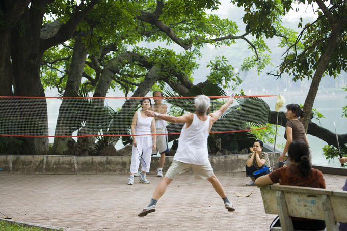 Morning badminton game beside Hoan Kiem Lake.