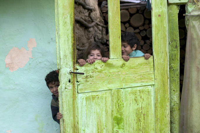 Gypsie children playing in their house, Transylvania.