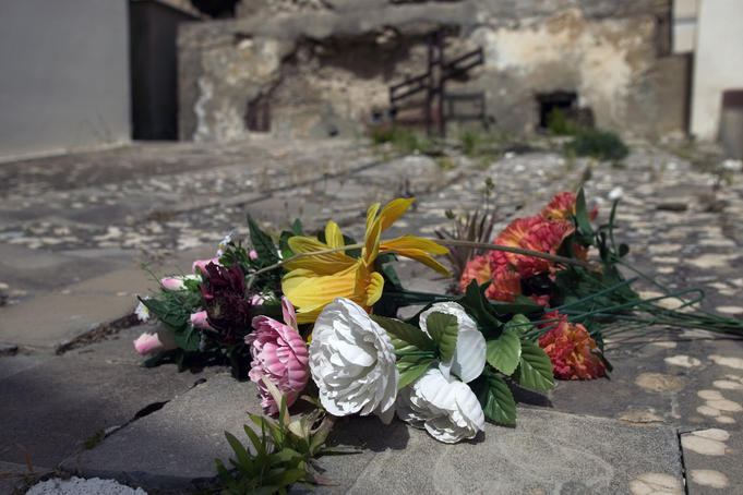 Bouquets on cobblestones, Sicilian City of the Dead.