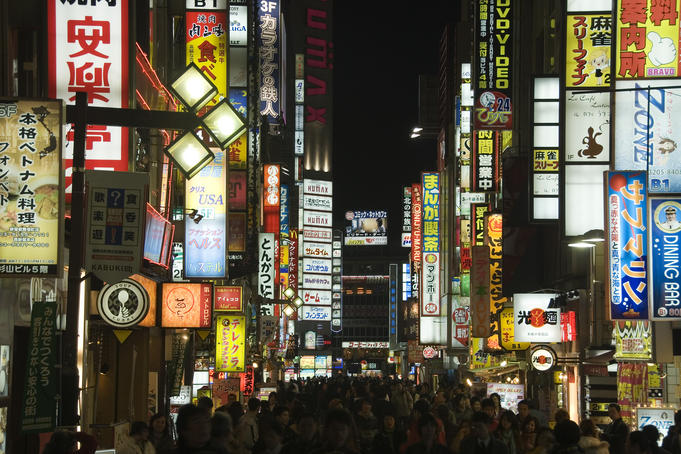Colourful night-time lights of Shinjuku's vibrant shopping and entertainment precinct.