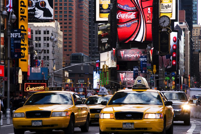 Traffic and neon signs in Times Square.