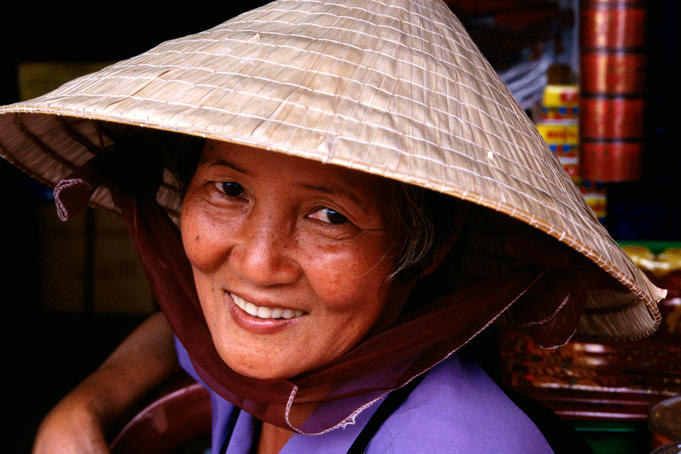 Vietnamese woman wearing traditional hat.