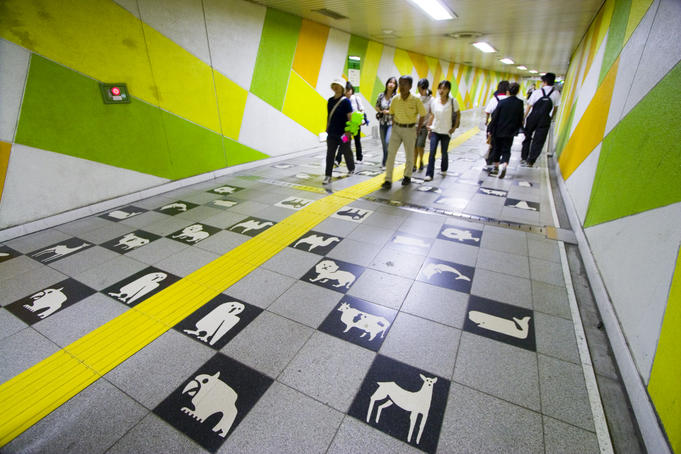 Chequerboard floor tile pattern of animals in Maruyama Subway Station, the entrance to the Maruyama Zoo.