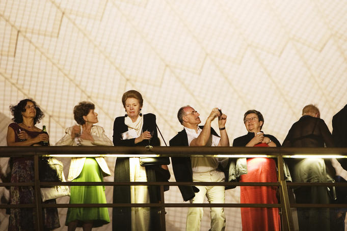 Patrons on balcony of Sydney Opera House.