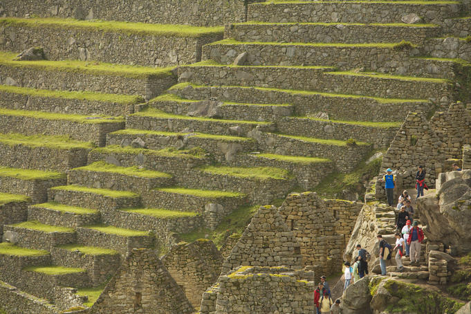 Tourists explore the stone ruins of Machu Picchu