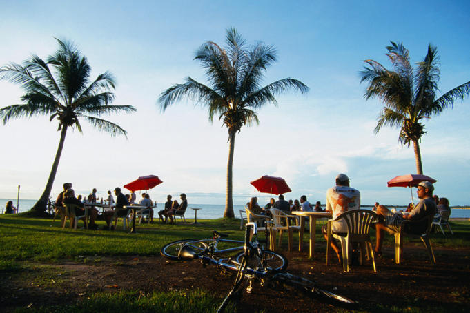 Drinking in the beer garden of the Darwin water-ski club at sunset - Darwin, Northern Territory