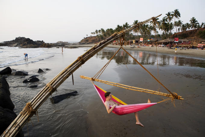 Relaxing in makeshift hammock erected on a section of Vagator Beach known as Disco Valley.