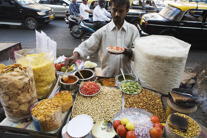 Vendor sells bhelpuri on the street.