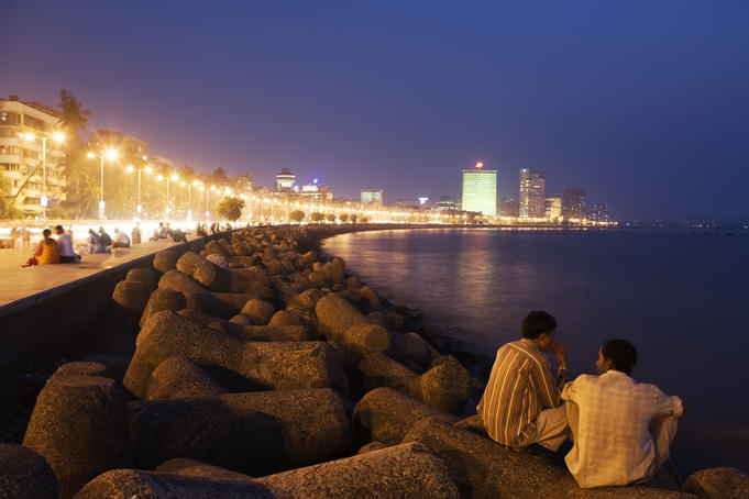 People relax at the end of day along Marine Drive.