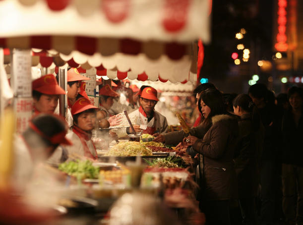 Night market food stalls in Wangfujing.