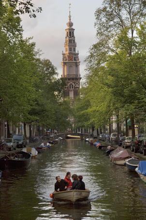 NETHERLANDS, North Holland Province, Amsterdam View looking down Groenburgwal at sunset in the southern canal belt. No Model Release,