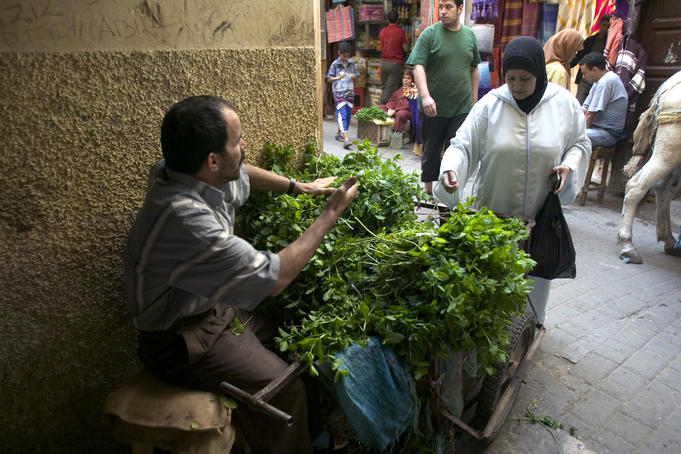 Man selling mint among narrow allies of Medina.