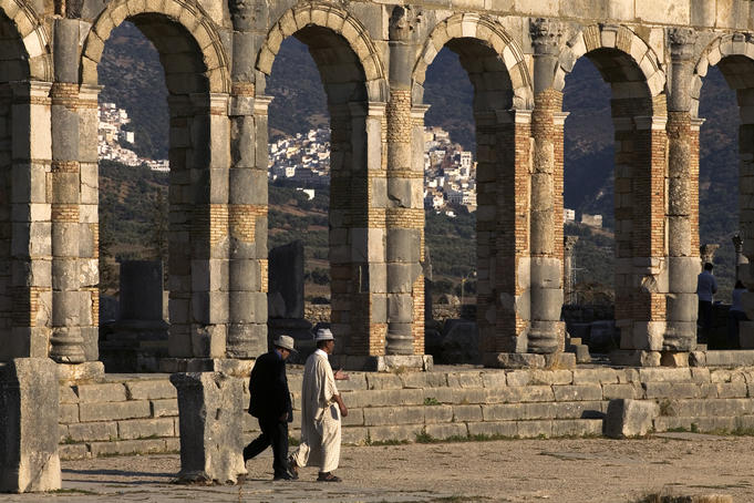 Men visit the remains of the Roman city of Volubilis.