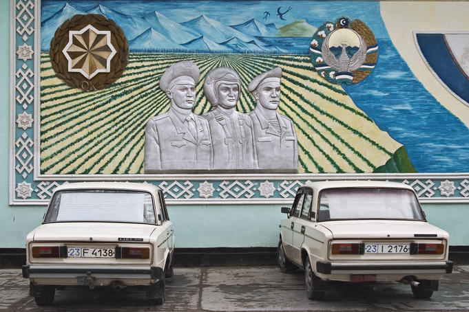 Mural on the side of a building depicting various types of Uzbke military men.