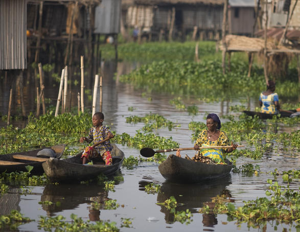 Women in canoes among stilt houses, Lake Nokoue near Cotonou.