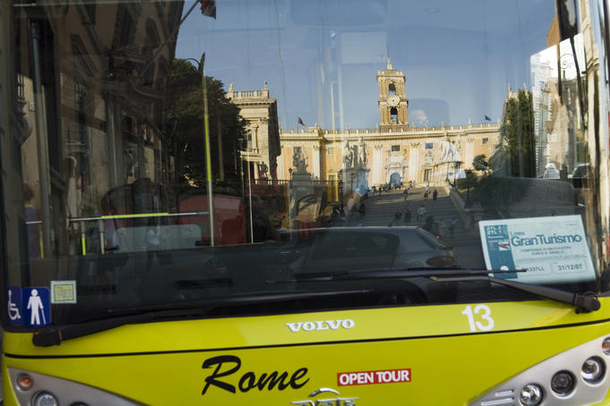 Piazza del Campidoglio reflected in bus at sunset, Centro Storico area.