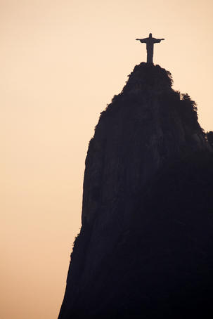 Silhouette of Cristo Redentor (Christ the Redeemer) statue on the summit of Corcovado.