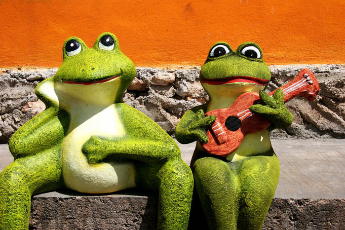 Ornamental Mexican frogs playing guitar.