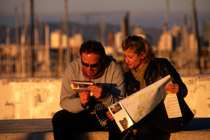 Couple look at maps and guidebook