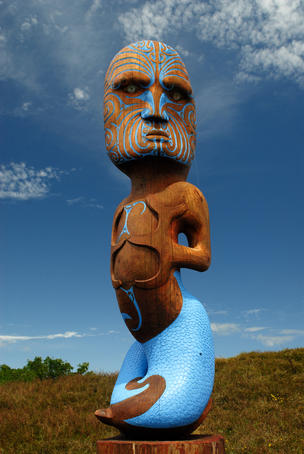 Pouwhenua Maori carved pole of Tangaroa God of the Sea.